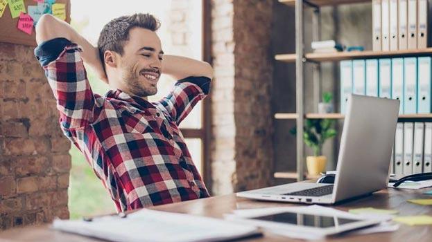 happy man at computer